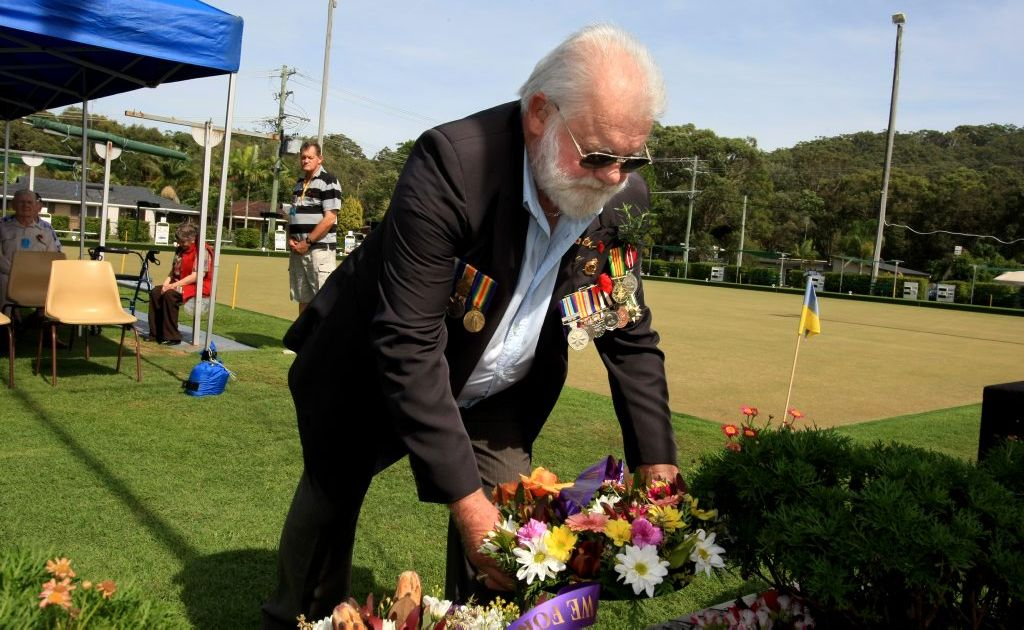 Phillip Johnstone attends an early Anzac service at Cabarita Beach on Monday.