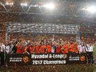 Brisbane Roar players celebrate after winning the A-League grand final at Suncorp Stadium.