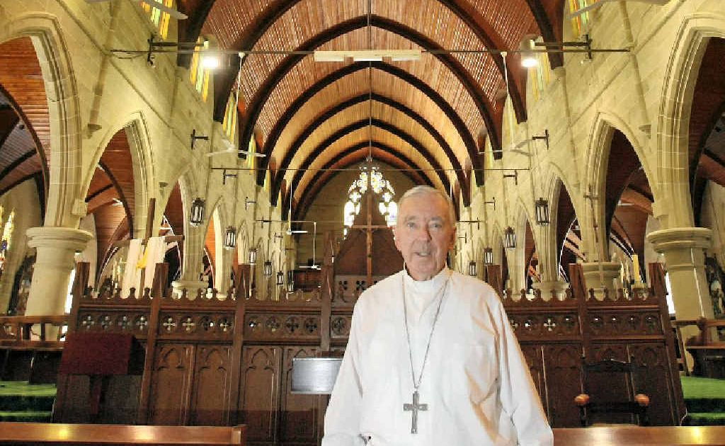 Bishop Brian Heenan stands in one of the areas of Rockhampton's St Joseph's Cathedral that has been restored.