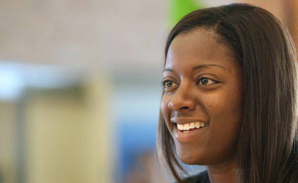 Cyclones forward Shanavia Dowdell is all smiles after arriving at Rockhampton Airport yesterday.