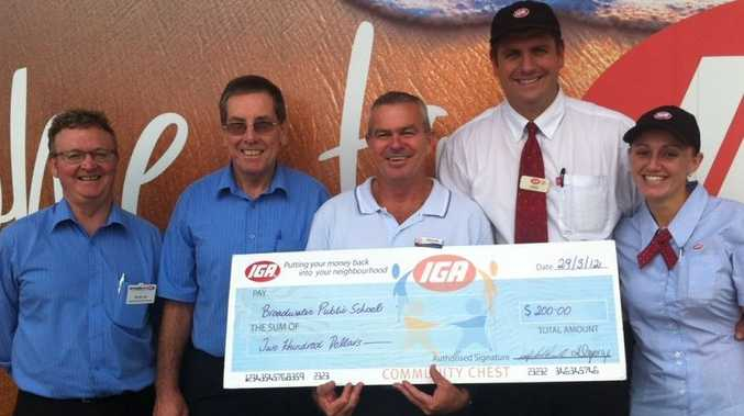 Principal of the Broadwater Public School Steve Curtin accepts a donation of $200 from Peter Lee (Ritchies IGA Manager), Graham Phillips (Ritchies IGA Manager), Leigh Fitz-Gerald (Evans Head Manager), and Kristy George, (Owner) of Evans Head IGA supermarket. Photo Contributed