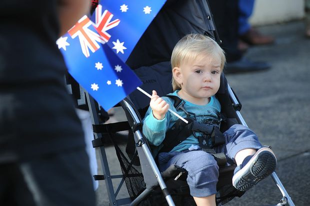 A toddler looks on during Lismore's annual Anzac Parade.