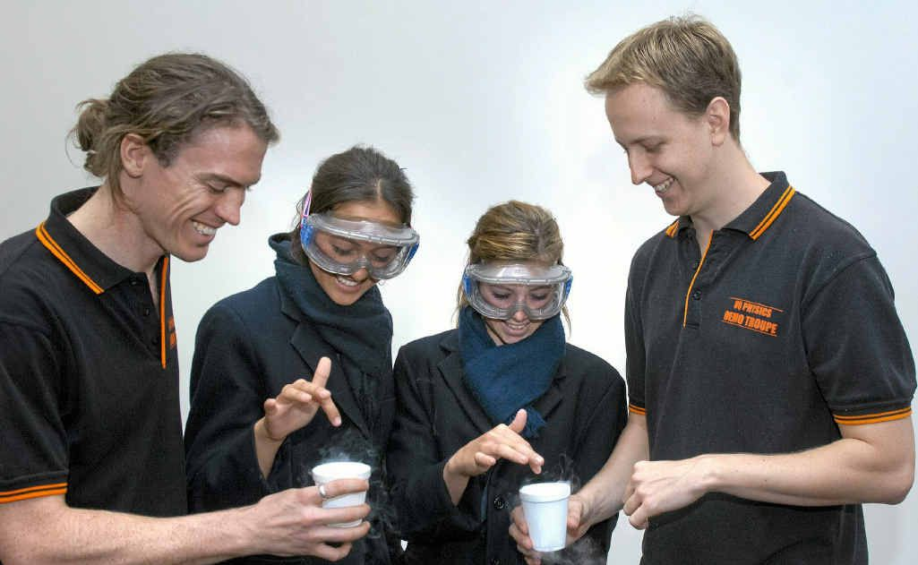 The Scots PGC College students Tiffany Cullen and Hayley Lang get shown an experiment by science outreach guys Dr Andrew Stephenson (right) and Glen Harris (left).