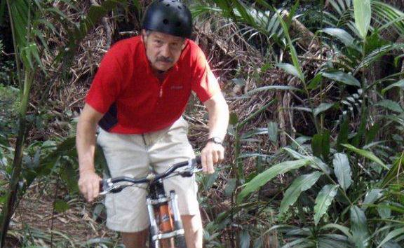Eddie Roberts riding some of the trails that stretch around his property at Uki.