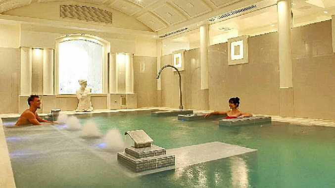 INDULGENT BLISS: Relax in the unique hydromassage and soak the pain away.