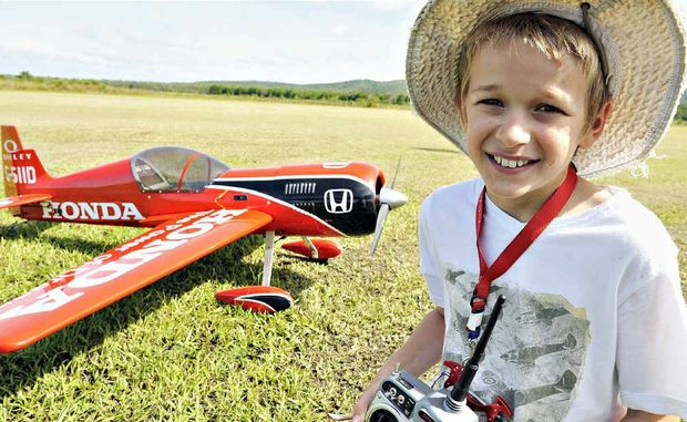 Buderim flyer Matthew Wood, 11, with his 'Sukhoi' model aircraft, which he flew at the Suncoast Model Flyers Air Show.