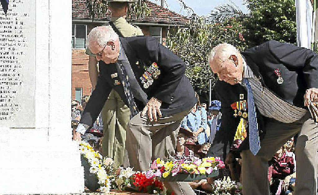 Veterans lay wreaths in honour of the fallen.