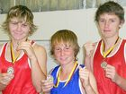 Not gold this time, but still medals, held by Lachlan Doo (left), Zac Lovekin and Samuel Dyson.