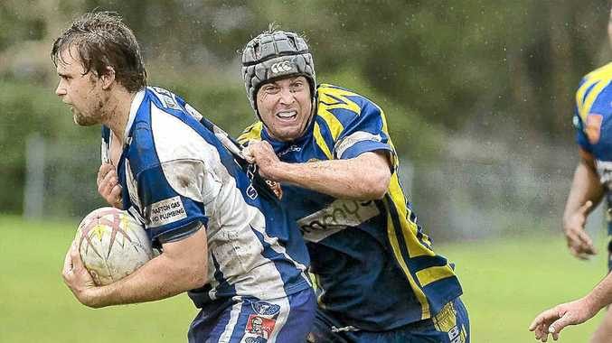 Marist Brothers' Brendan Brooke tackles Grafton Ghosts' Aaron Hartmann on Sunday at Crozier Field.