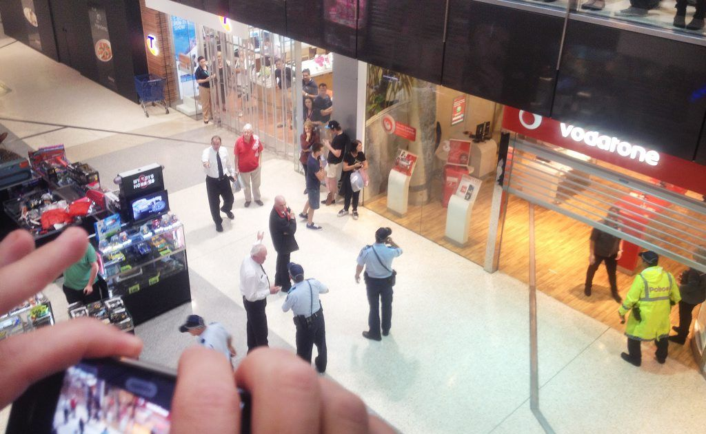 People filmed and photographed the incident as police worked.