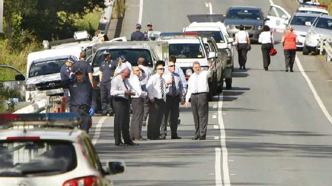 Police cars block Mt Crosby Road close to where the body of missing woman Allison Baden-Clay was found.