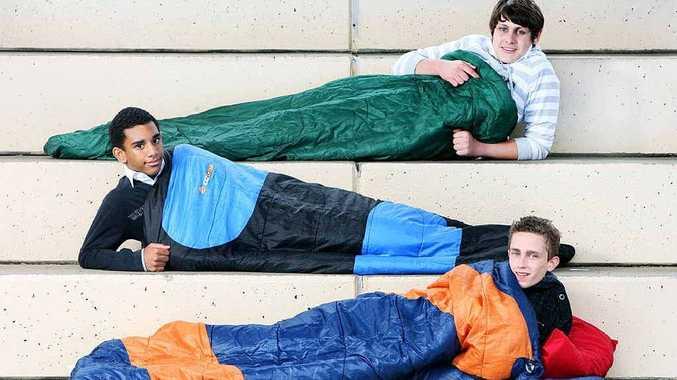 St Edmunds College students Joel Marschke (bottom), Alfred Durutamata and Jake Biddle sleep out.