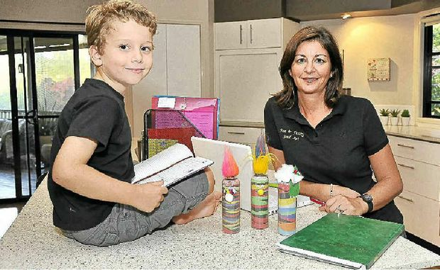 TOP TEAM: Jayne Lawlor, with the help of her son Joshua, 5, is running her business Fun and Funky Sand Art from home.