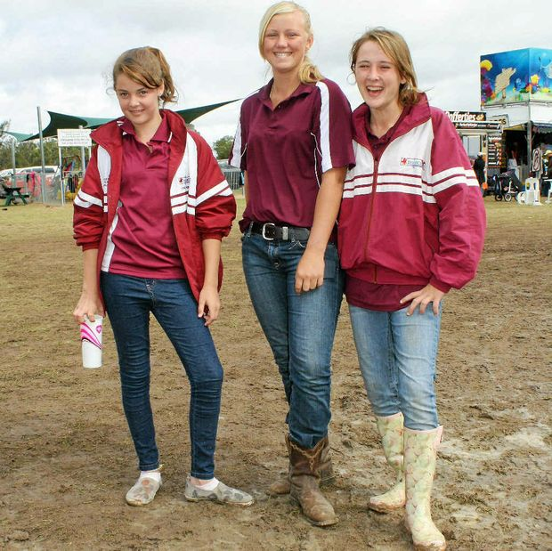 Sophie Forster, Maddie Burton and Sally Gilbert sloshed through the Morgan Park polocrosse grounds at the weekend.