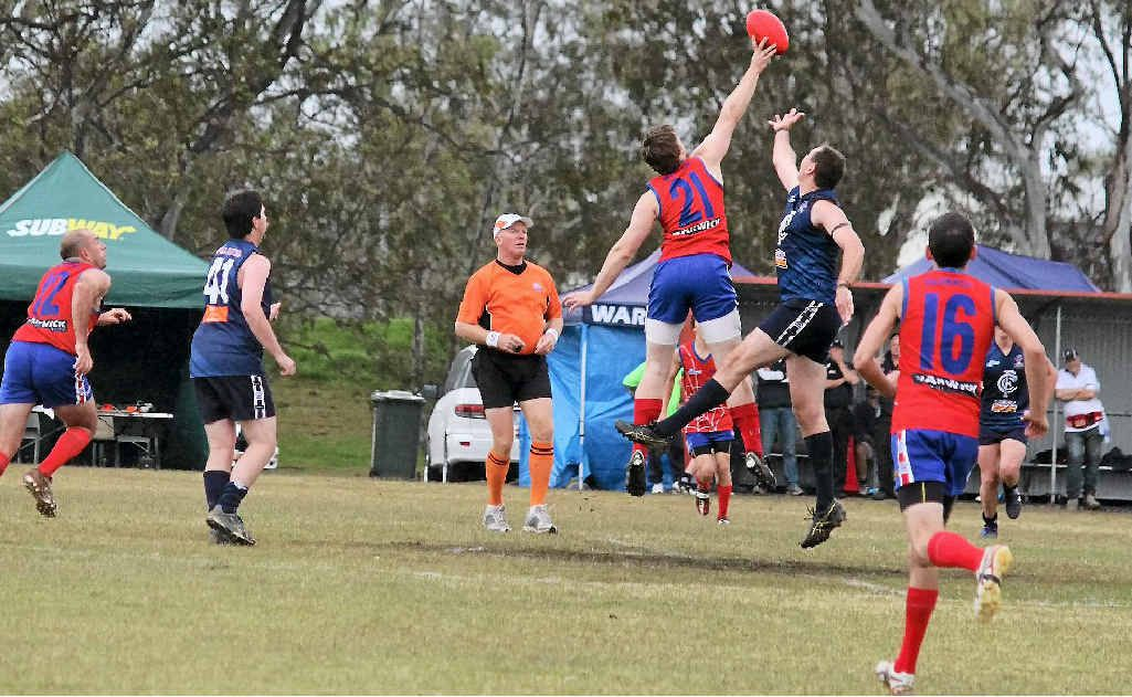 Redbacks player Alex Cutmore (21) goes for the ball against Coolaroo at Roddie's Oval.