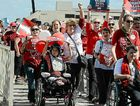 People with disabilities and their supporters march in Brisbane to demand a National Disability Insurance Scheme.
