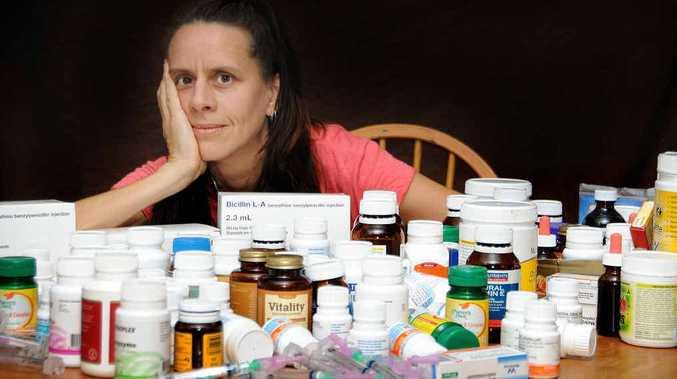 Sabine Gaber with some of her medication.