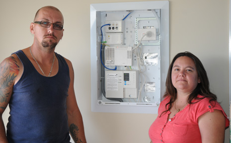 FLICK THE SWITCH: Sean and Teresa Hook show their house is connected and ready to go for NBN and phone services in the new Grantham Estate, but are unable to be switched on for services just yet.
