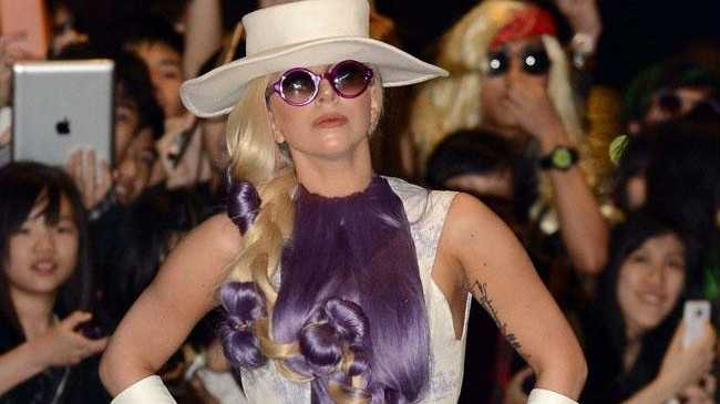Pop star Lady Gaga has admitted she uses facelift tape