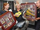 Andrea McGahan (left), Margaret Wright and Ken Furdek with some of the items to be auctioned at the Mayor's Charity Ball.