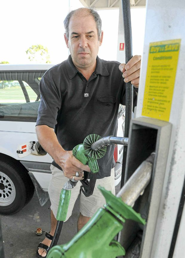 lan Baxter fills up the tank at the Sugarland Matilda. Bundaberg fuel prices are higher than further south in Brisbane.