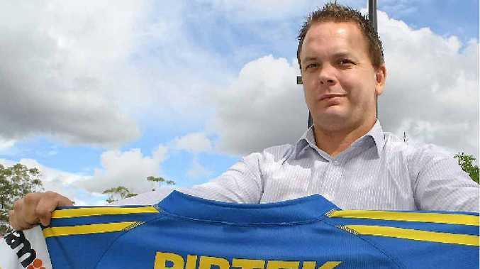 Collegians coach Tim Doyle with Nathan Hindmarsh's game jersey, which will be auctioned off at Collegians.