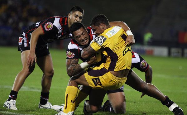 Josh Hoffman of the Broncos tackles Feleti Mateo of the Warriors during the round nine NRL match between the New Zealand Warriors and the Brisbane Broncos at Mt Smart Stadium