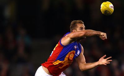 Joel Patfull of the Lions handballs during the round six AFL match between the Essendon Bombers and the Brisbane Lions at Etihad Stadium