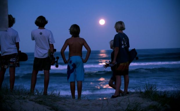 Watching the full moon rise over the water at Peregian. Photo:Warren Lynam / Sunshine Coast Daily
