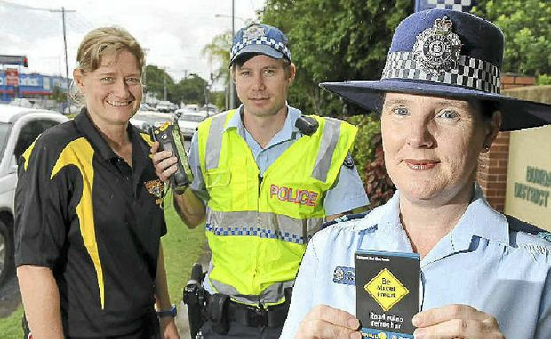 "North Bundaberg High's Larissa Hill, Constable Ryan Thompson and Senior Constable Danielle Loftus discuss the new ""Road Safety"" project."