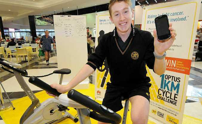 Shaun Lee wins the Optus 1km time trial at Centro as part of the Tour de Cure fundraising and awareness campaign and takes home a brand new smart phone.
