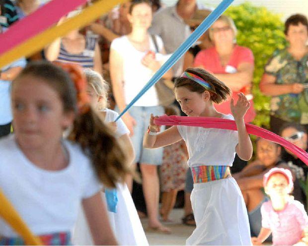 Hampden State School's Kiara Robinson and Tia Penshorn perform the Maypole folk dance as part of the school's 125-year celebrations.