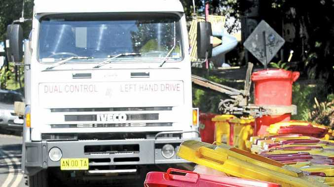 A dump truck empties dozens of bins in Nimbin after MardiGrass at the weekend.