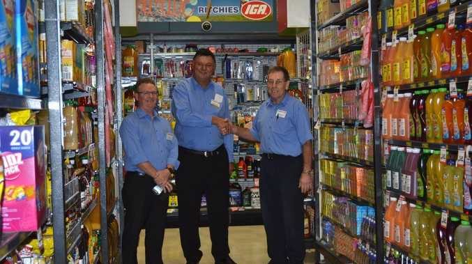 IGA HANDOVER: Ritchies CEO Fred Harrison (centre) shakes hands with store manager Graeme Phillips with state manager for Queensland and Northern NSW Peter Lee. Photo Samantha Elley / Rivertown Times