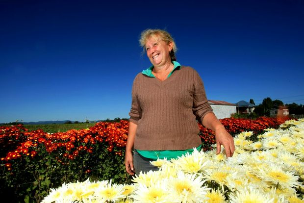 Crystal Creek Flowers owner Janelle Wright with some of her flowers.