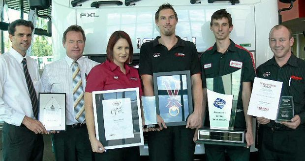 WINNERS ARE GRINNERS: The Brisbane ISUZU team with its award.