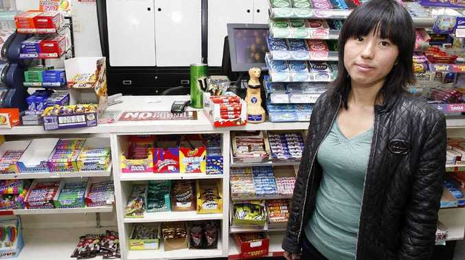 Ida Tang was left shaken after being held up while working at a convenience store yesterday. Photo: Sarah Harvey