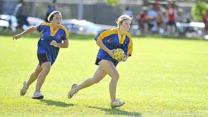 Trinity Catholic College's Jenna Lees (with the ball) has been picked for the Lismore Diocesan Touch team for the CCC Championships in Tamworth next month.