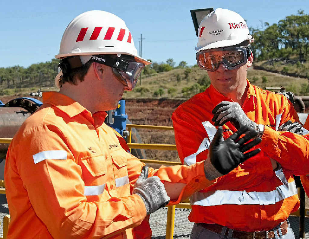 Rio Tinto chief executive Tom Albanese (right) being briefed at Yarwun by Rio Tinto Alcan's president and CEO of bauxite and alumina Pat Fiore.