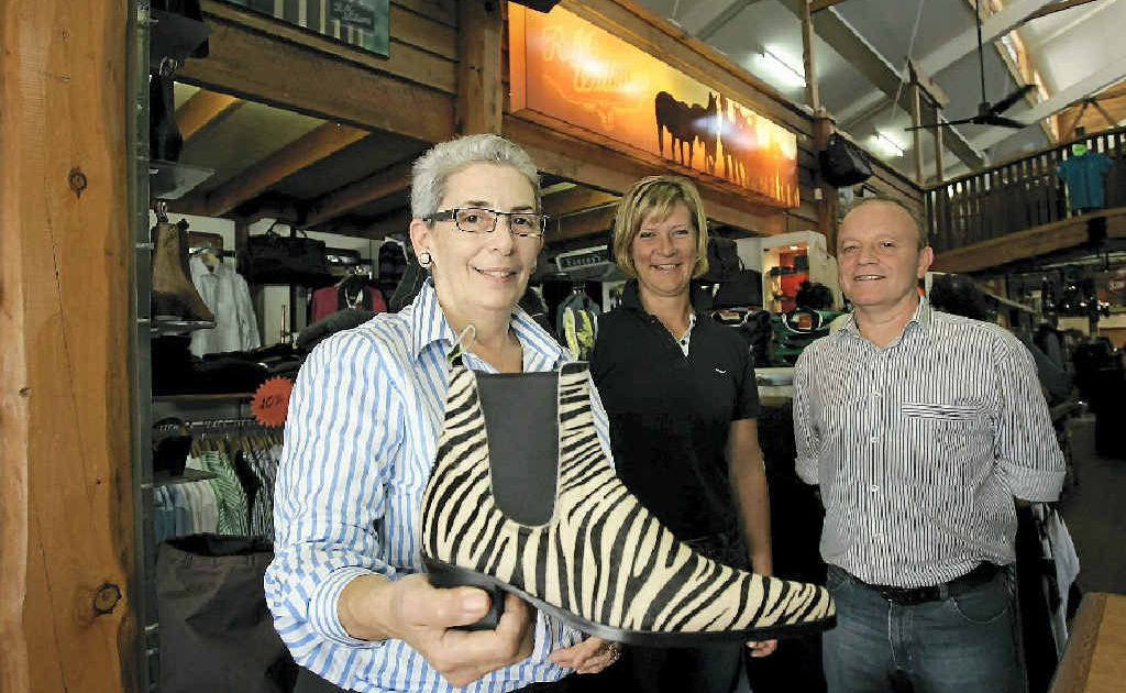 Catherine George, from Georges, shows one of the popular items sold during Beef Week, with Queensland agent for RM Williams Julia Spann and Adelaide-based RM Williams sales agent Steve Harris.