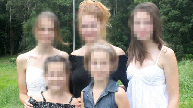 The distraught mother with her daughters whom the Family Court has ruled must fly to Italy on Tuesday. The image has been distorted for legal reasons.