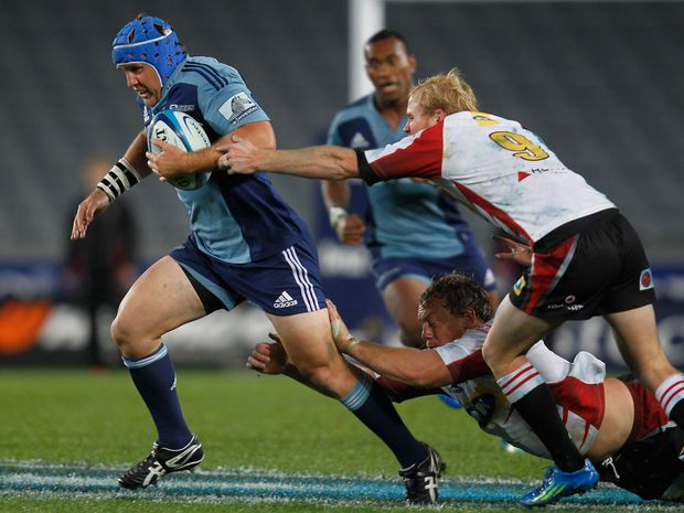 Blues James Parsons breaks away from Lions Ross Cronje during the round 12 Super Rugby match between the Blues and the Lions at Eden Park