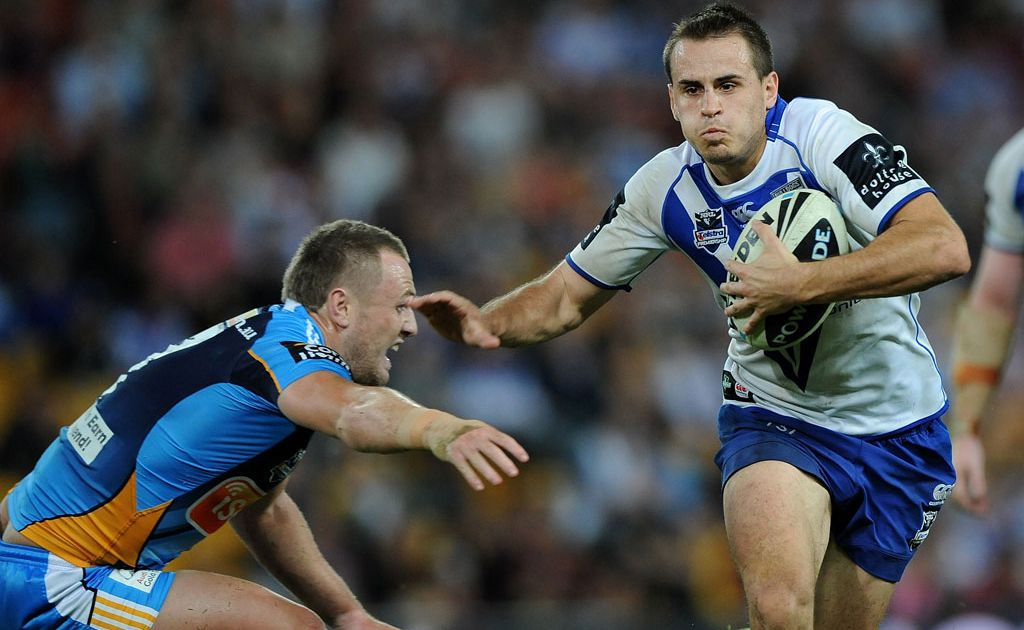 Josh Reynolds of the Bulldogs runs the ball in attack during the round 10 NRL match between the Canterbury Bulldogs and the Gold Coast Titans at Suncorp Stadium
