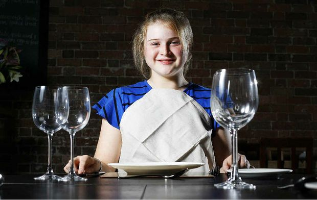 Olivia Orchard-Gibb, 13, prepares for a lesson in dining table etiquette.
