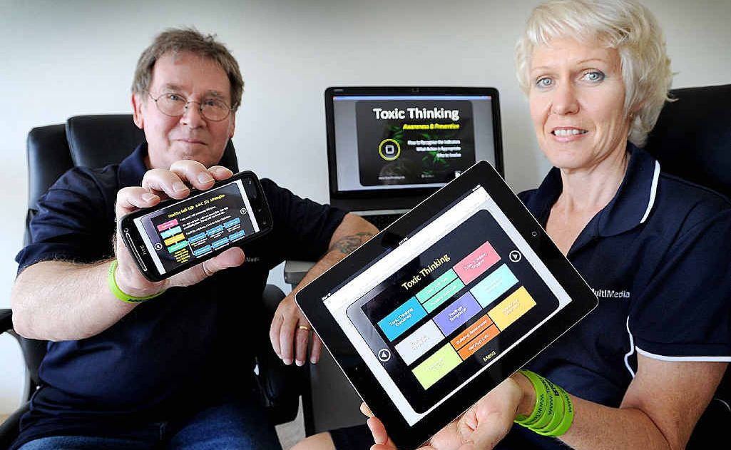 Trevor and Annie Boulton with their Toxic Thinking app.