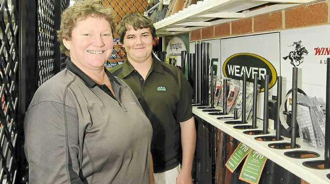 Owner of North Coast Firearms Sharon Greber and assistant Lachlan Donnelly in the shop's gun storage area.