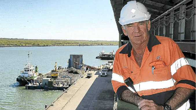 Queensland Sugar Limited workplace co-ordinator Garry Allen surveys the progress of the loading of quarried stone on to the first barge bound for Curtis Island, Gladstone.