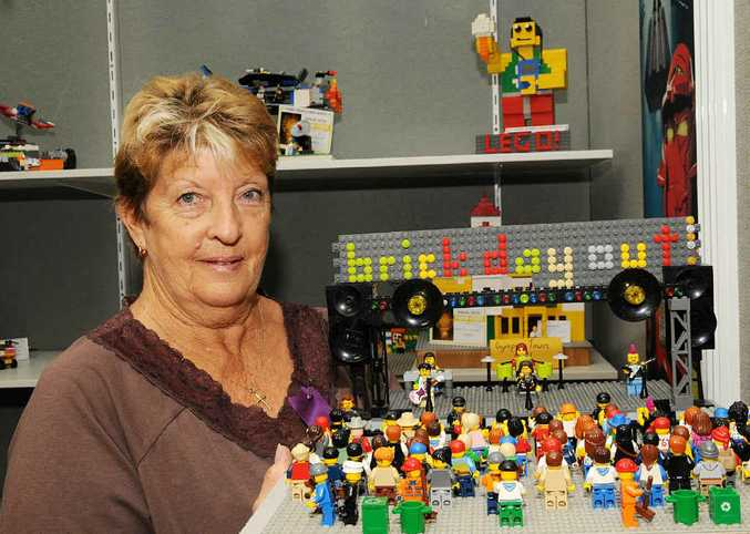 Lego steward Cheryl Patterson hold's Jeremy Wilson's Brick Day Out which won first place in the age 7-9 original design category.