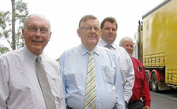 Member for Wide Bay Warren Truss and Member for Hinkler Paul Neville inspect a highway black spot.