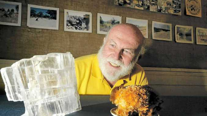 Lismore Gem and Lapidary club president Bruce Copper, with calcite and gypsum specimens, is ready for Gemfest.